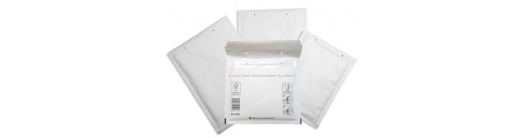 Oblazinjene kuverte bele
